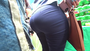 Brazilian milf in tight blue dress pants.