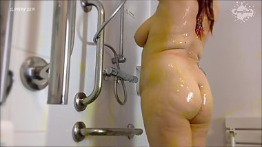 Messy slimy bbw in the shower after sploshing with gunge