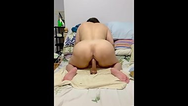 Mature Asian BBW riding a big dildo