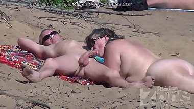 Chubby mature sucking cock on the beach