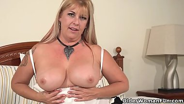 Busty milf Joclyn Stone gives hairy pussy a finger treatment