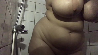 Horny big tits babe taking shower